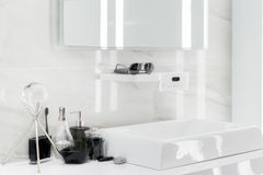 Electronic Washbasin with decoration in bathroom Stock Photos