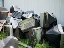 Electronic Waste. A pile of old unwanted CRT computer monitors and television or TV sets are now e-waste, electronic waste, e-scrap, or Waste Electrical and stock image