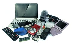 Electronic waste, gadgets for daily use and broken on white royalty free stock photography