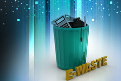 Electronic waste in green trash can Royalty Free Stock Photography