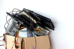 Electronic Waste. In old cardboard box stock photos