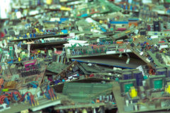 Electronic waste ready for recycling. Mainboard computer-Viltage filter royalty free stock photography