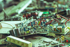 Electronic waste ready for recycling. Mainboard computer-Viltage filter stock image