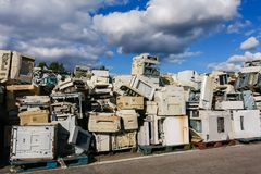 Electronic waste for recycling. Modern electronic waste for recycling or safe disposal, any logos and brand names have been removed. Great for recycle and stock photo
