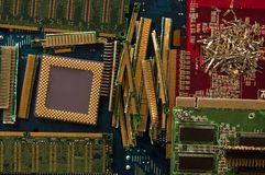 Electronic waste recycling from old computer parts. Gold mining from old computer parts and processors. Gold recovery from computer parts stock photos