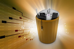Electronic waste in trash can Stock Photos