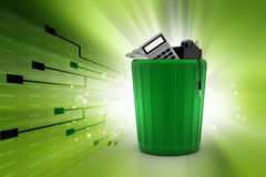 Electronic waste in trash can Royalty Free Stock Photography
