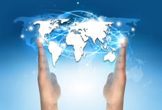 Electronic world map communication. Between hands stock image