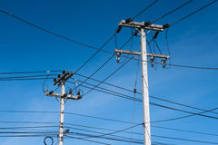 Electronicity post on blue sky Royalty Free Stock Images