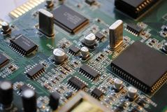 Electronics. The computer electronic card with chips, microprocessors, transistors, explorers and other electronic parts Royalty Free Stock Images
