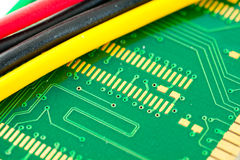 Electronics. Green electronics and colored wires Royalty Free Stock Photos