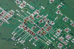 Electronics. Green board with electronics components, focus in center Royalty Free Stock Images
