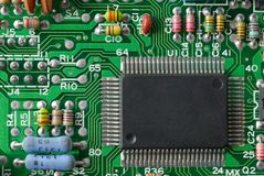 Electronics. Printed circuit board with some electronic parts Stock Photo