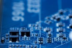 Electronics. Background in blue with shallow DoF royalty free stock images