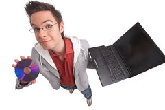 Electronics. Young man holding a dvd and a notebook with clipping path included Stock Photos