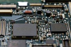 Electronics background technology close up of the green kit circuit board. Application Specific Integrated Circuit royalty free stock image
