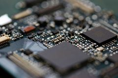 Electronics background technology close up of the green kit circuit board. Application Specific Integrated Circuit royalty free stock images
