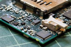 Electronics background technology close up of the green kit circuit board. Application Specific Integrated Circuit stock image