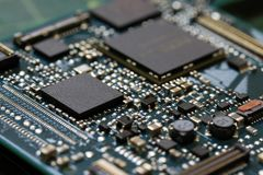 Electronics background technology close up of the green kit circuit board. Application Specific Integrated Circuit stock photo