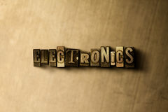ELECTRONICS - close-up of grungy vintage typeset word on metal backdrop Royalty Free Stock Photos