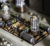 Electronics component on vintage tube vacuum amplifier radio. Royalty Free Stock Photos
