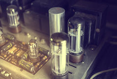 Electronics component on vintage tube vacuum amplifier radio. Royalty Free Stock Image