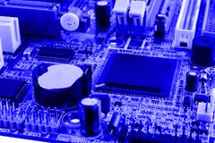 Electronics components on modern PC computer motherboard with RAM connector slot and CPU Socket Stock Images