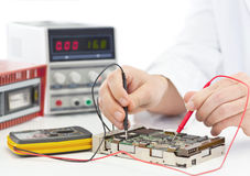 Electronics engineer. Testing computer part in electronics workshop Royalty Free Stock Photography