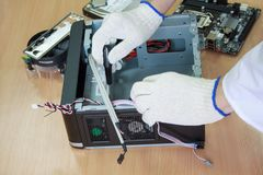 Electronics engineer assembles a personal computer. Stock Images