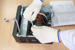 Electronics engineer making a personal computer. Instruction for assembly. Hands and accessories of closeup Stock Photography
