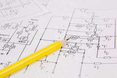 Electronics and Engineering. Pencil on printed drawings of elect. Rical circuits royalty free stock images
