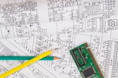 Electronics and Engineering. Printed drawings of electrical circuits, electronic board and pencils. Science, technology and elect royalty free stock photography