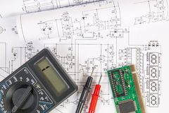 Electronics and Engineering. Printed drawings of electrical circuits, electronic board and digital royalty free stock photography