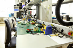 Electronics equipment assembly workplace Stock Images