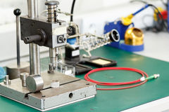 Electronics equipment assembly workplace Stock Photography