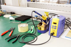 Electronics equipment assembly workplace. With solder and necessary tools Royalty Free Stock Images