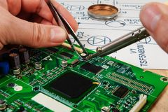 Electronics manufacturing services, manual soldering of electronic board. From spare parts royalty free stock images