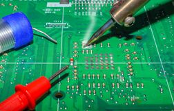 Electronics manufacturing services, Motherboard digital chip. Tech science background. Integrated communication processor stock photo