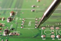 Electronics manufacturing services, soldering of electronic board. Close-up stock image