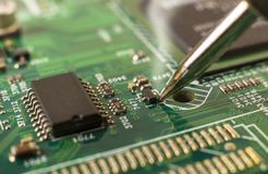 Electronics manufacturing services, soldering of electronic board. Close-up stock photos