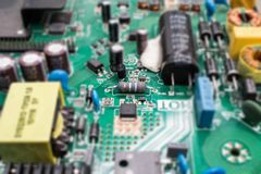 The electronics parts on main board resistor and chip technology. The electronics parts on main board resistor and chip technology Royalty Free Stock Photos