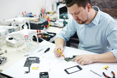Electronics Prodigy Assembling High Tech Devices Stock Photo