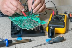 Electronics repair and metering. Parameters. Broken electronic board, professional repairman Stock Images