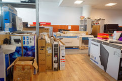 Electronics repair in service center. VILNIUS, LITHUANIA - AUGUST 14, 2015: Working room of small service center for repair of TVs and consumer electronics Royalty Free Stock Photos