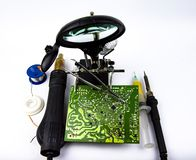 Electronics repair - soldering iron, soldering station, magnifier royalty free stock photos