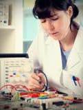 Electronics repair tech, toned image stock images