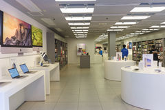 Electronics shop interior. HONG KONG - APRIL 16, 2015: electronics shop with Apple gadgets. Apple Inc. is an American multinational corporation headquartered in Stock Photos