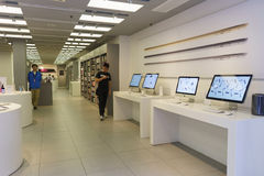 Electronics shop interior. HONG KONG - APRIL 16, 2015: electronics shop with Apple gadgets. Apple Inc. is an American multinational corporation headquartered in Royalty Free Stock Photo