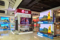 Electronics store. HONG KONG - NOVEMBER 02, 2015: TVs on display at electronics store in New Town Plaza. New Town Plaza is a shopping mall in the town centre of stock image