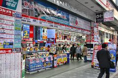 Electronics store in Japan. KYOTO, JAPAN - APRIL 18, 2012: Customers enter Bic Camera in Kyoto, Japan. Bic Camera group had 9.049 billion yen net income in 2011 Royalty Free Stock Photography